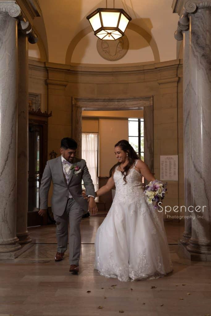 bride and groom entering their wedding reception at Ariel Pearl
