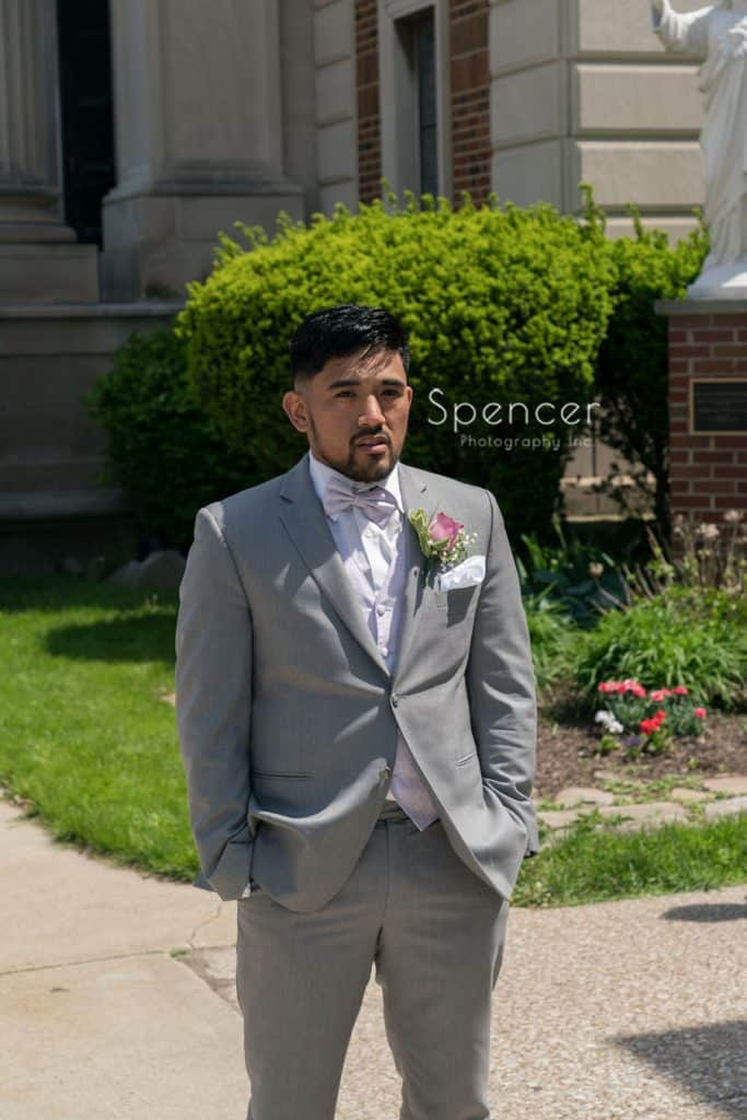 groom waiting for wedding day first look