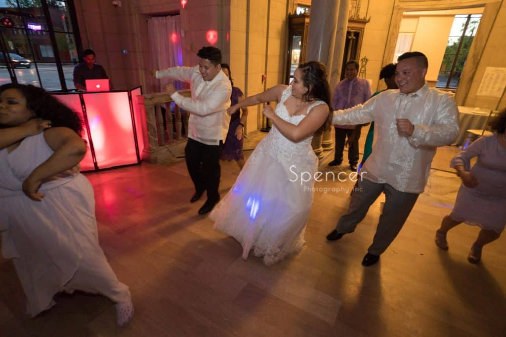 bride dancing with her brothers at Ariel Pearl wedding reception