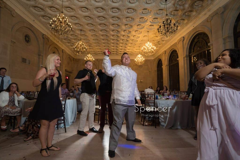 garter toss at wedding reception at Ariel Pearl