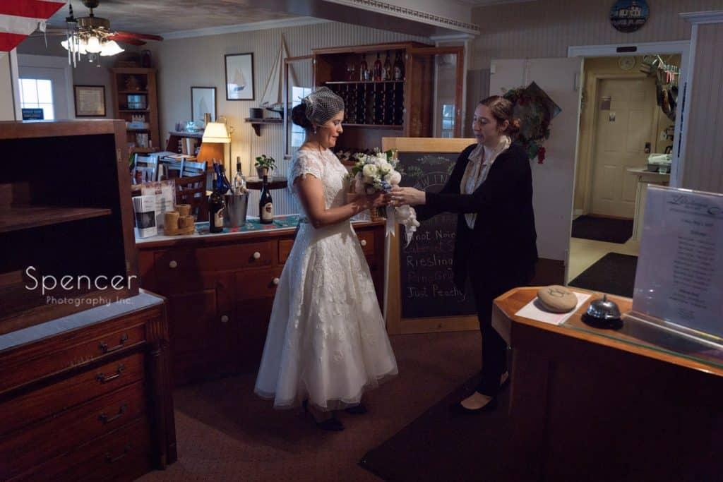 Geneva wedding coordinator hand bride her bouquet