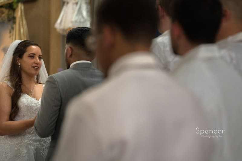 bride talking to groom during wedding ceremony in Cleveland