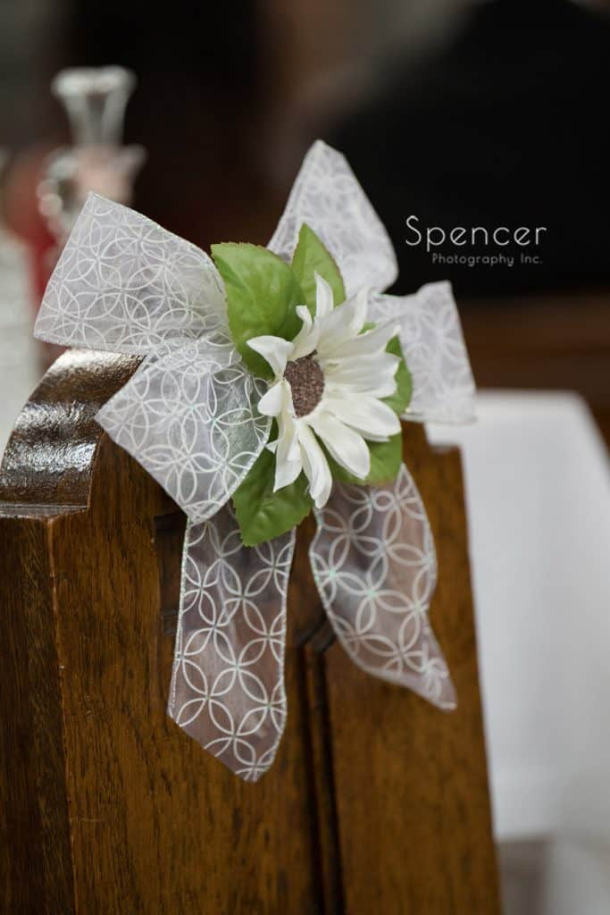 flower on pew at wedding ceremony in Cleveland