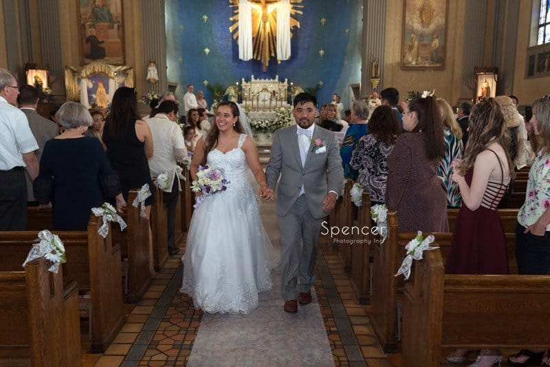 bride and groom recessional at wedding ceremony at Mary Queen of Peace Church