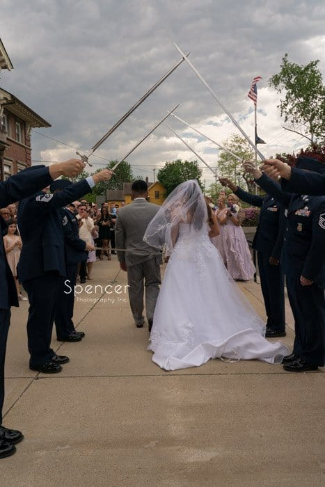 bride and groom pass thru air force honor guard at Cleveland wedding