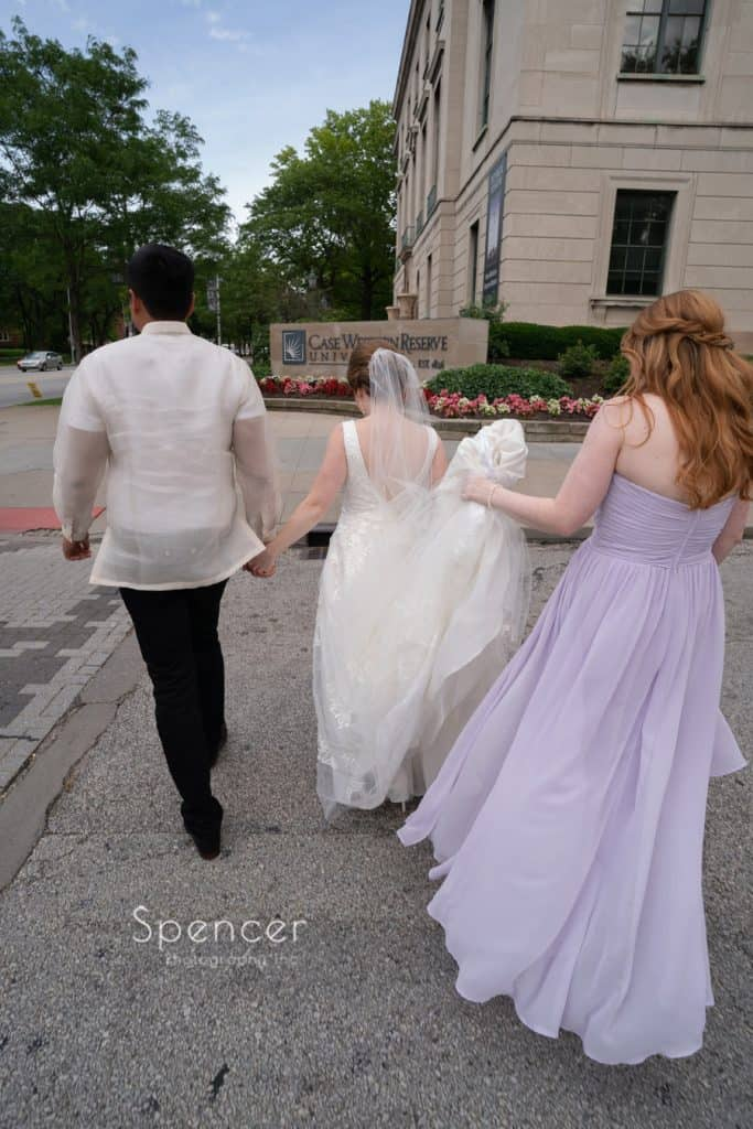 walking to Case Western Reserve on their wedding day
