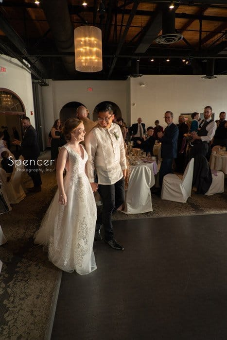 wedding couple enter reception at Windows on the River