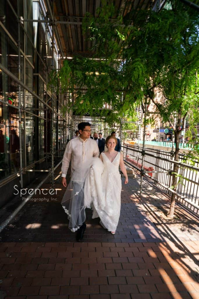 bride and groom walking to Cleveland Arcade on their wedding day