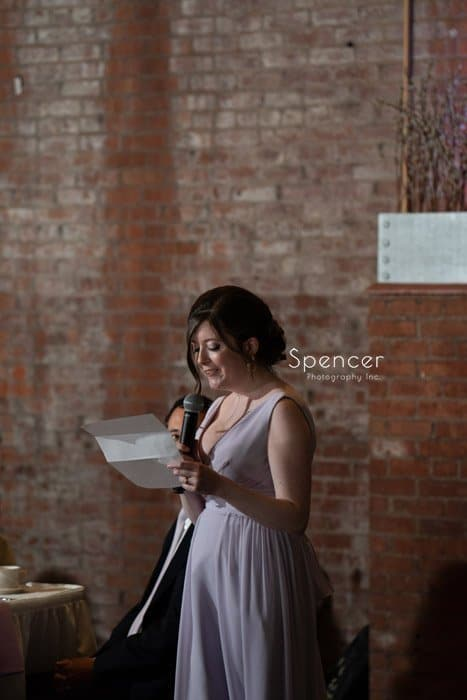 maid of honor giving reception speech at Windows on the River
