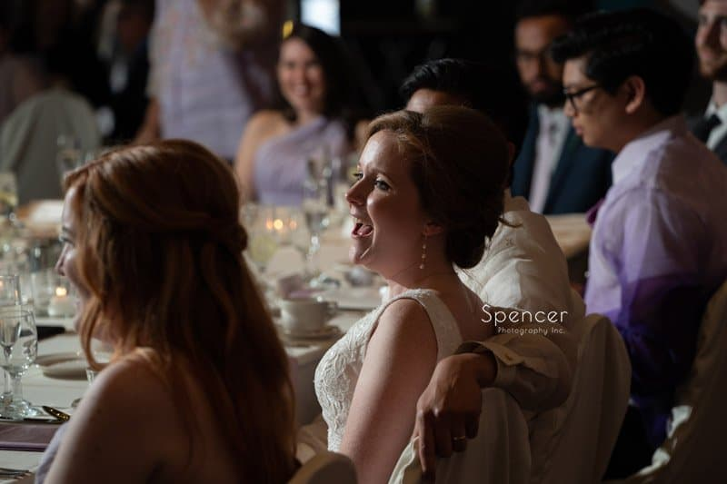 bride laughing at maid of honor speech at Windows on the River