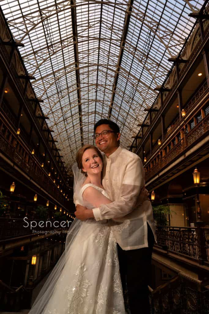 wedding picture of bride and groom in Cleveland Arcade