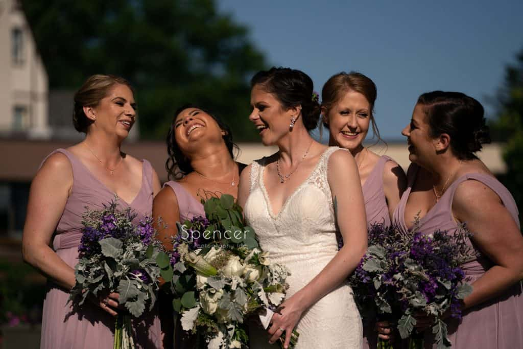 bride laughing with her bridesmaids at Columbia Hills Country Club