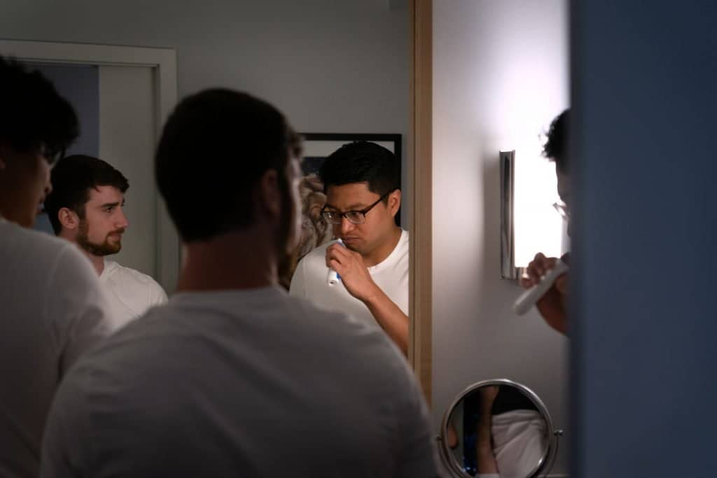 groom brushing teeth before wedding day at Kimpton Schofield Hotel