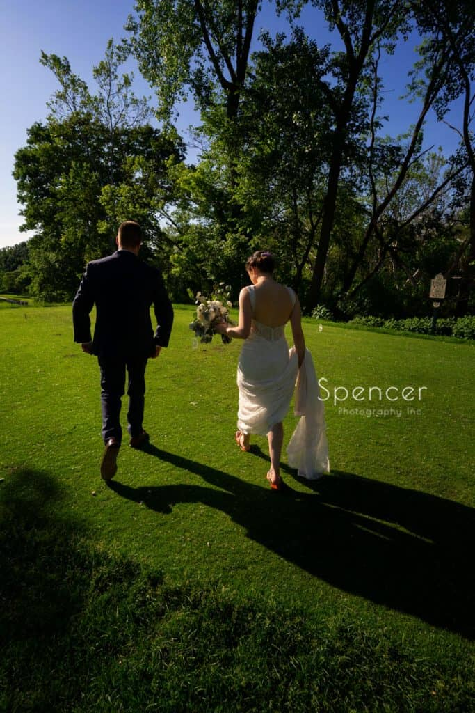 bride and groom walking on golf course at Columbia Hills Country Club
