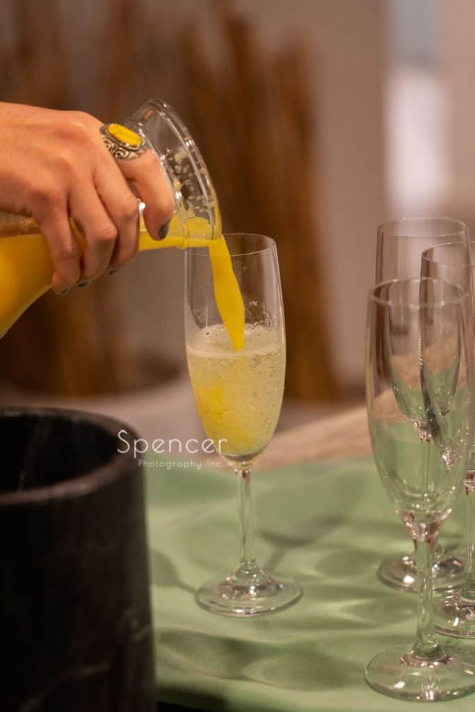 pouring mimosas at Columbia Hills Country Club wedding