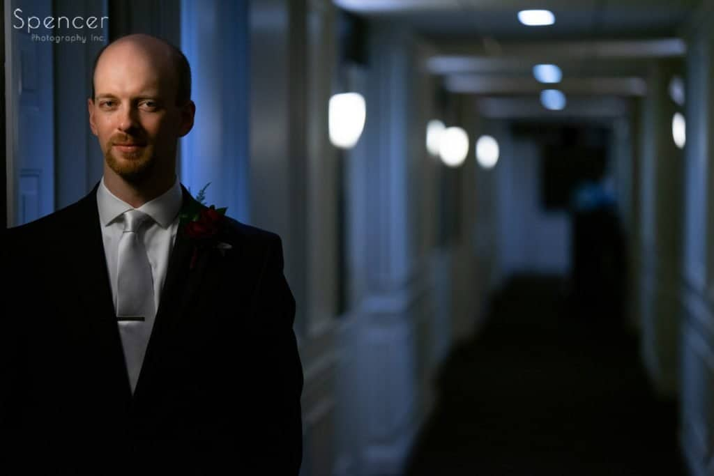 wedding picture of groom in hallway at Avalon Hotel