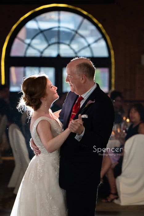 bride dancing with father at Windows on the River wedding reception