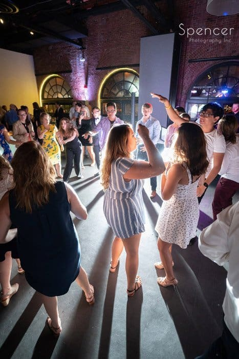 reception guests dancing at Windows on the River