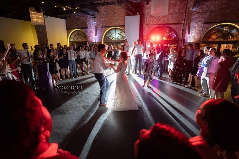 bride and groom dance at end of their reception at Windows on the River