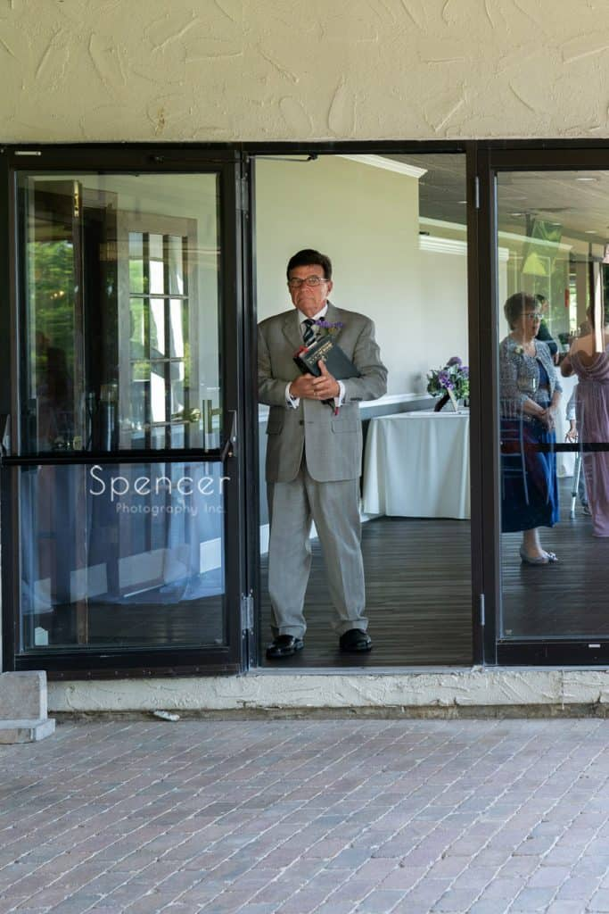 pastor standing waiting to start wedding at Columbia Hills Country Club