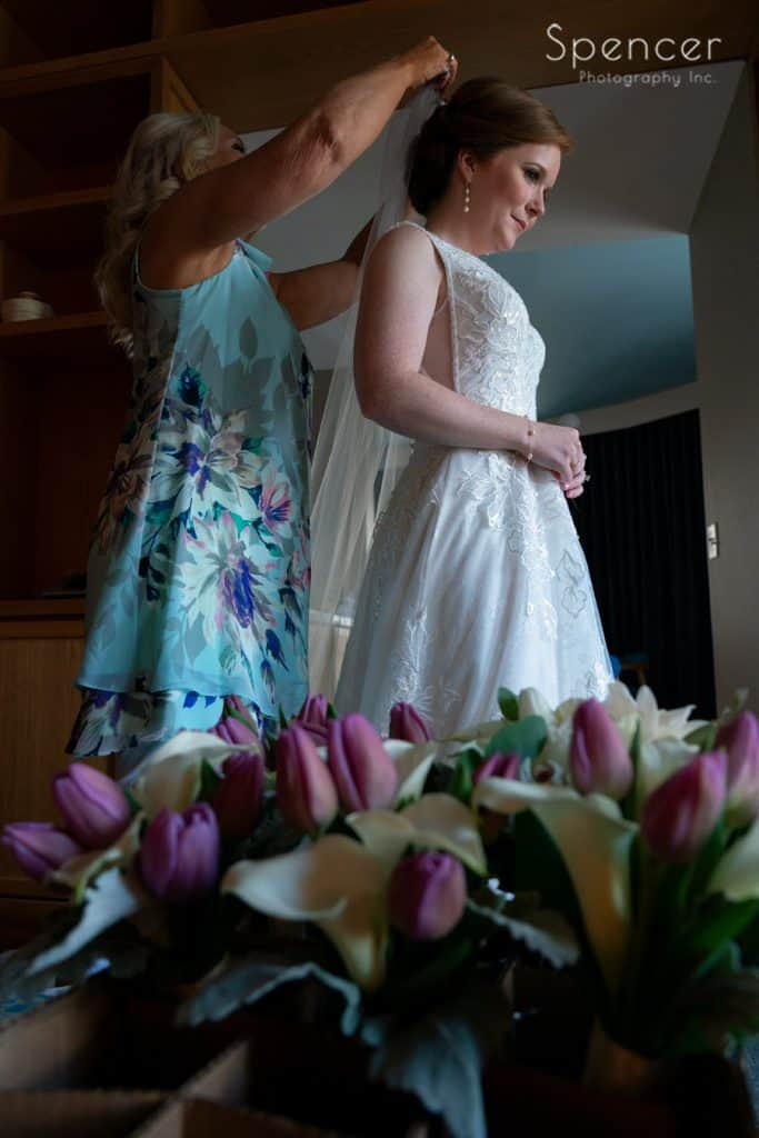 mom helping bride with veil at Kimpton Schofield Hotel