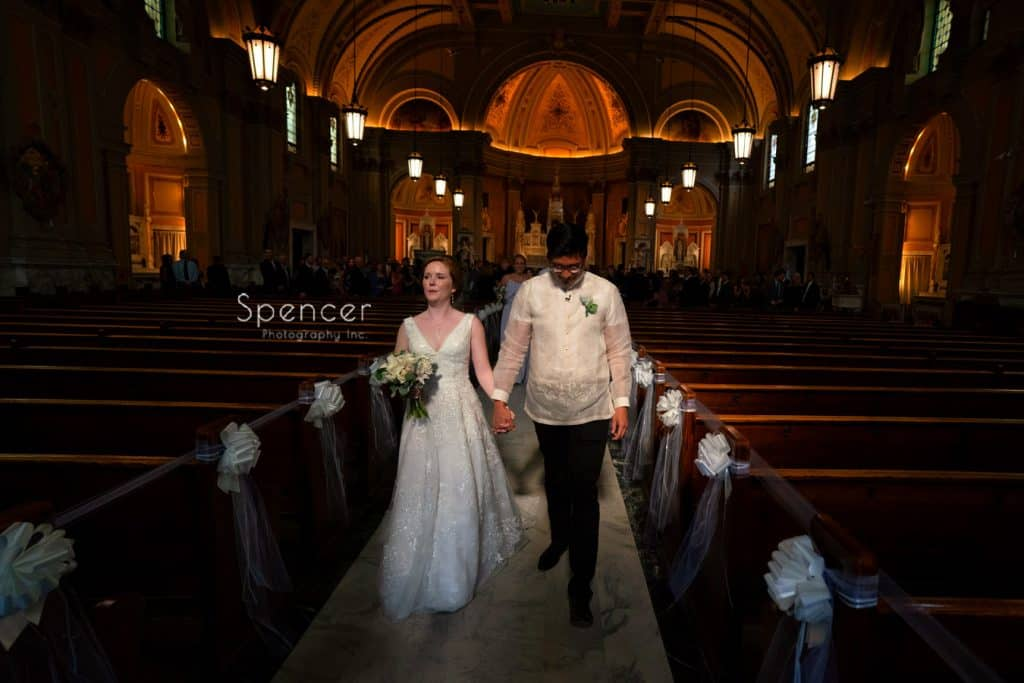 bride and groom exiting sactuary at St. Coleman Church