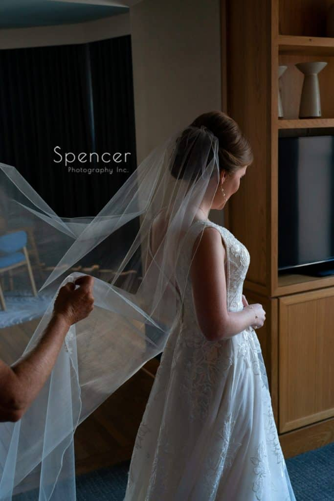 bride getting final touches on her wedding veil
