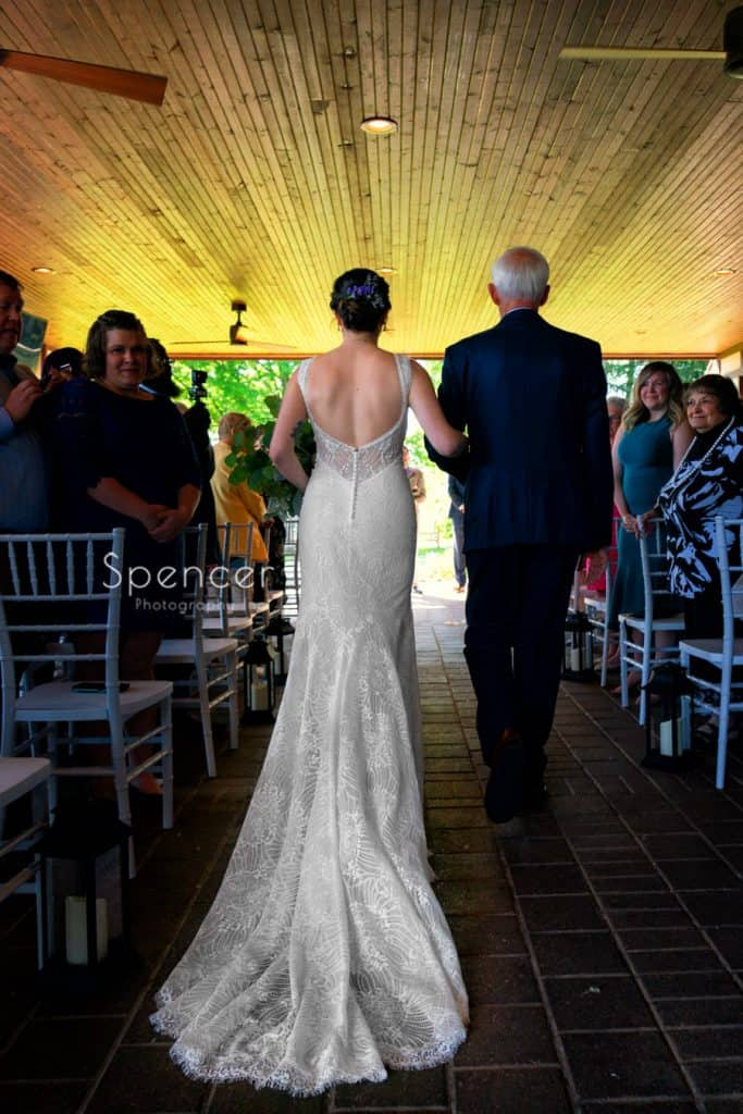 bride walking down aisle during wedding Columbia Hills Country Club