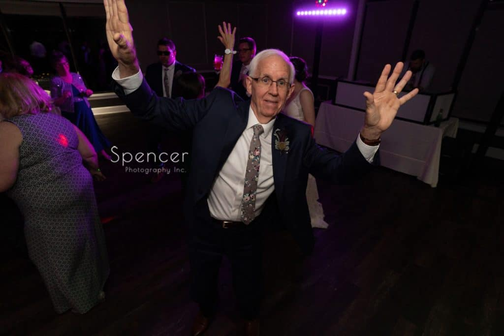 father of groom dancing at wedding reception at Columbia Hills