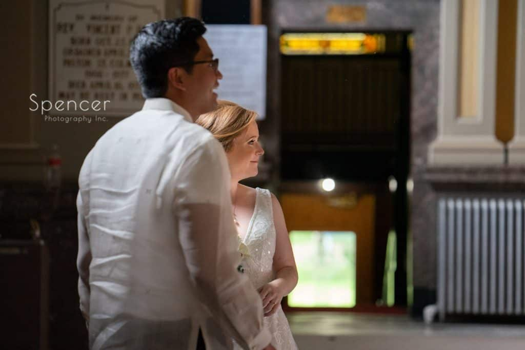 bride and groom greet guests after wedding ceremony at St. Coleman Chruch