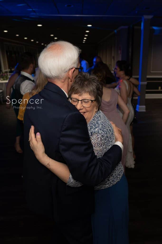 parents of groom hugging at wedding reception at Columbia Hills