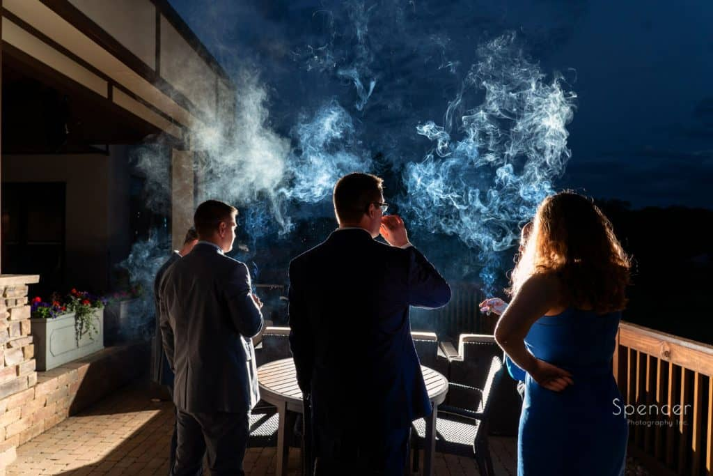 wedding guest have cigar at Columbia Hills wedding reception