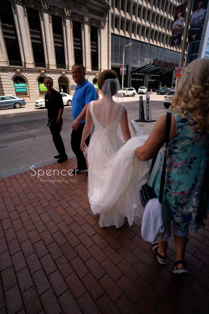 bride leaving Kimpton hotel for her wedding in Cleveland