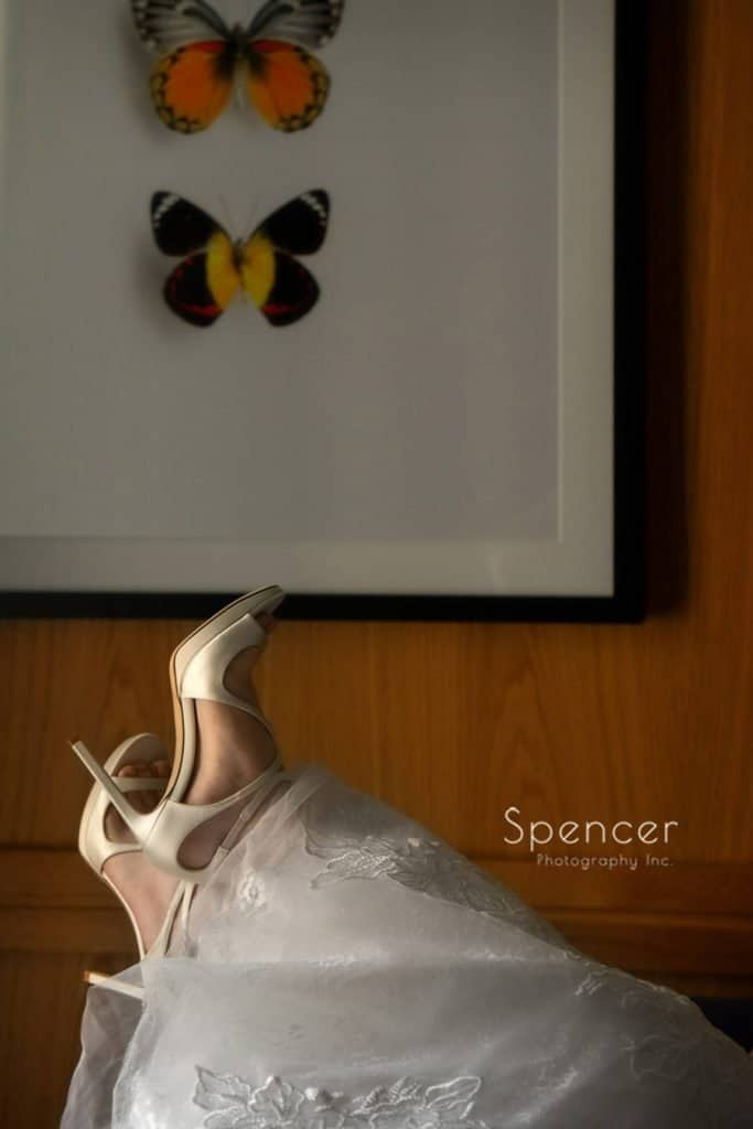 bride showing off her wedding Jimmy Choos at Kimpton Schofield Hotel Cleveland