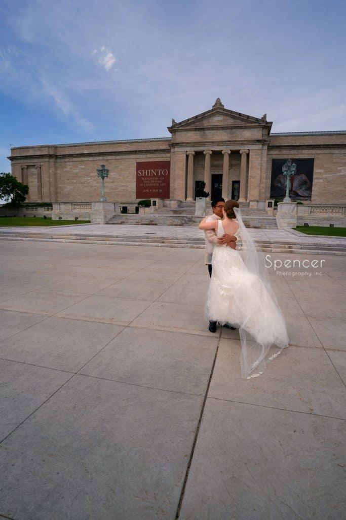 groom hugging bride at Cleveland Museum of Art wedding