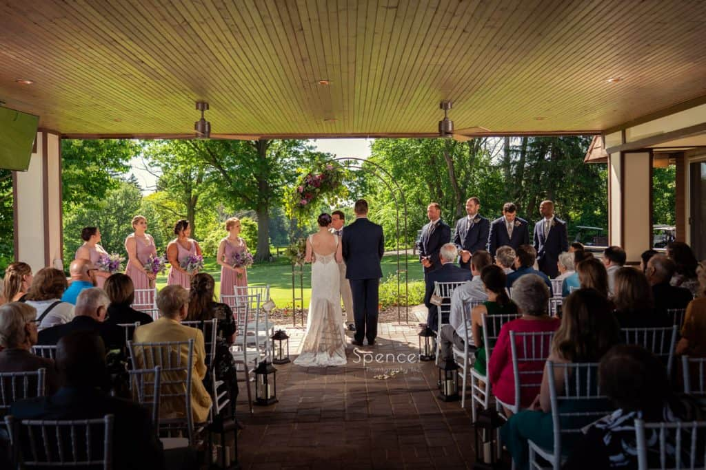 wedding ceremony on patio of Columbia Hills Country Club