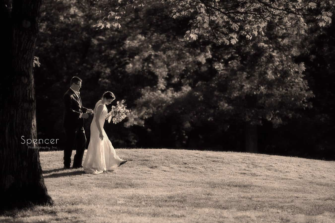 bride and groom walking on gold course at Columbia Hills Country Club