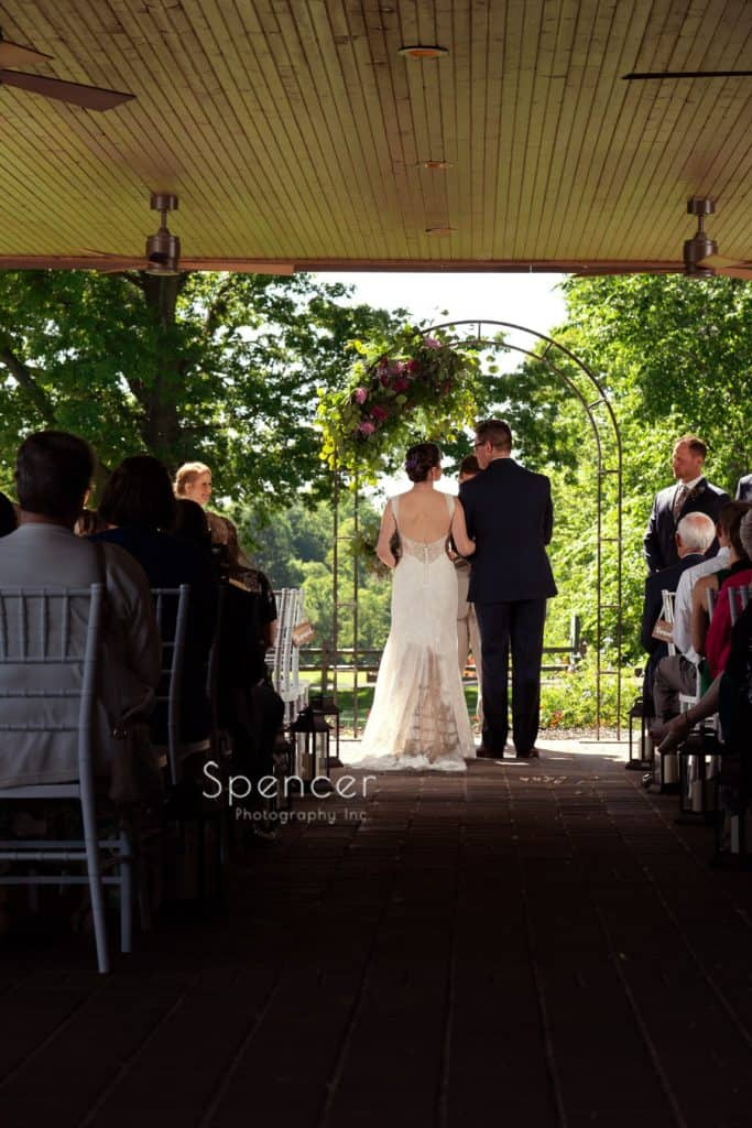 bride talking to groom during wedding ceremony at Columbia Hills Country Club