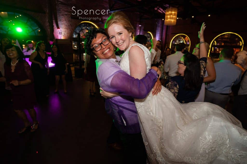 groomsman hugging bride