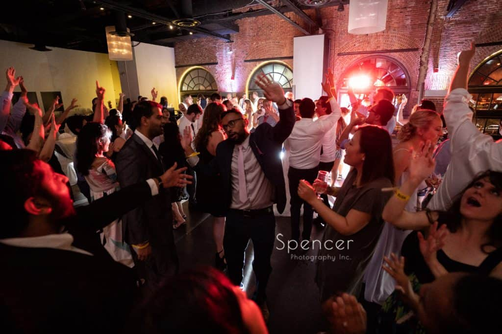 guests dancing at wedding reception at windows on the river
