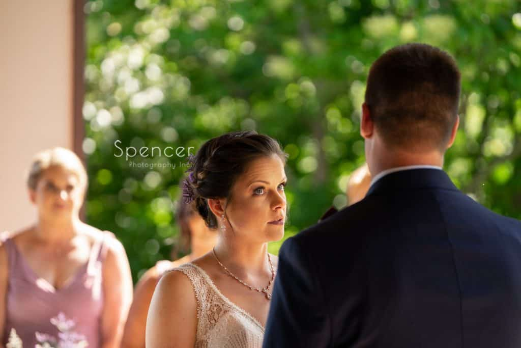 bride taking vows during wedding ceremony at Columbia Hills Country Club