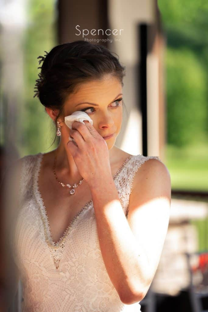 bride wiping away tear at wedding at Columbia Hills Country Club