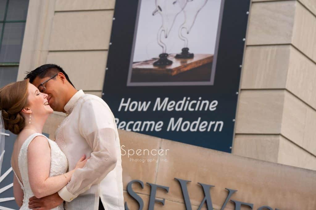 groom kissing bride at Case Western Reserve
