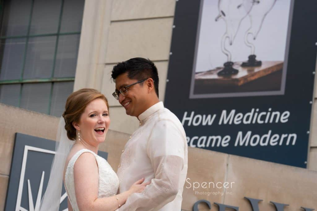 bride and groom laughing on wedding day at Case Western Reserve