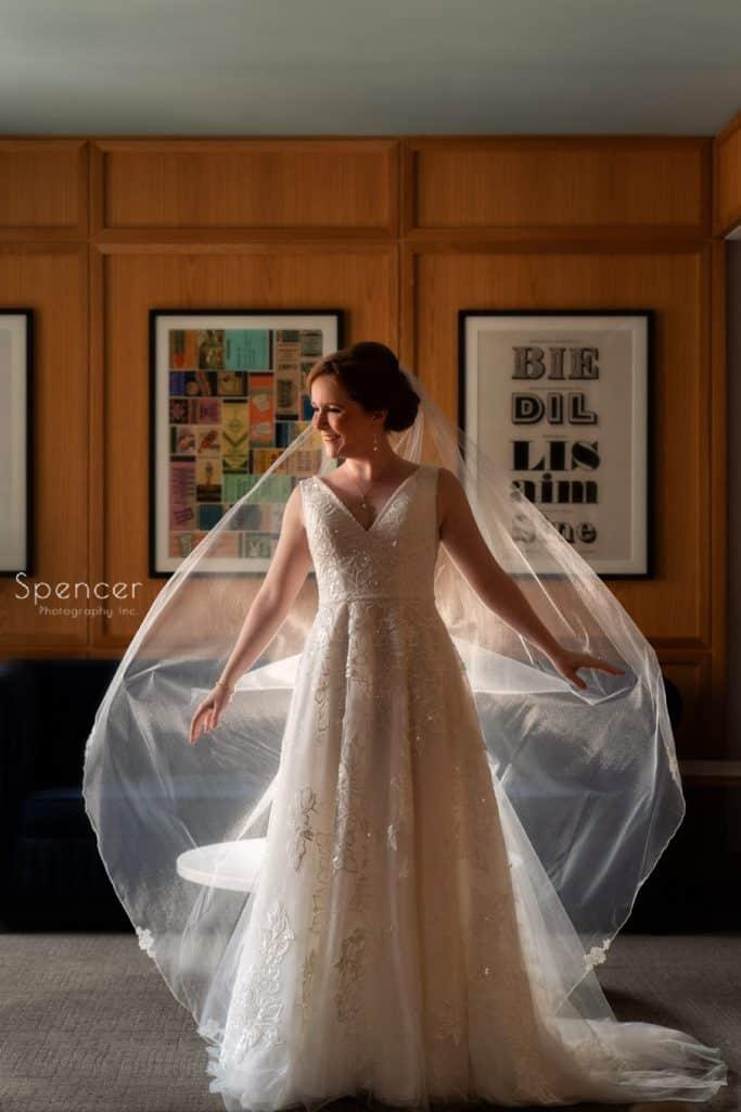 bride fluffing her wedding veil atKimpton Schofield Hotel Cleveland