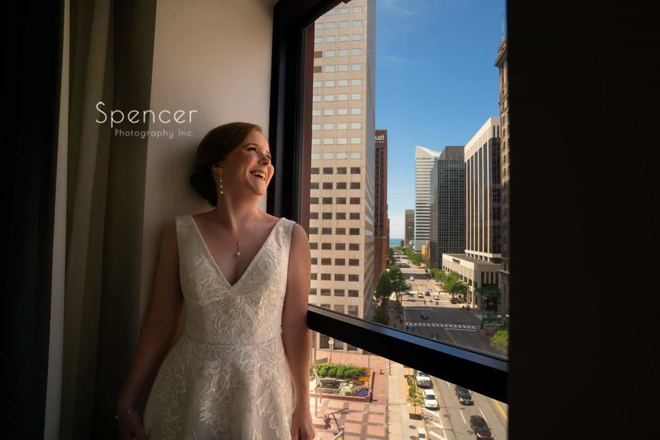 bride laughing in wedding picture atKimpton Schofield Hotel Cleveland