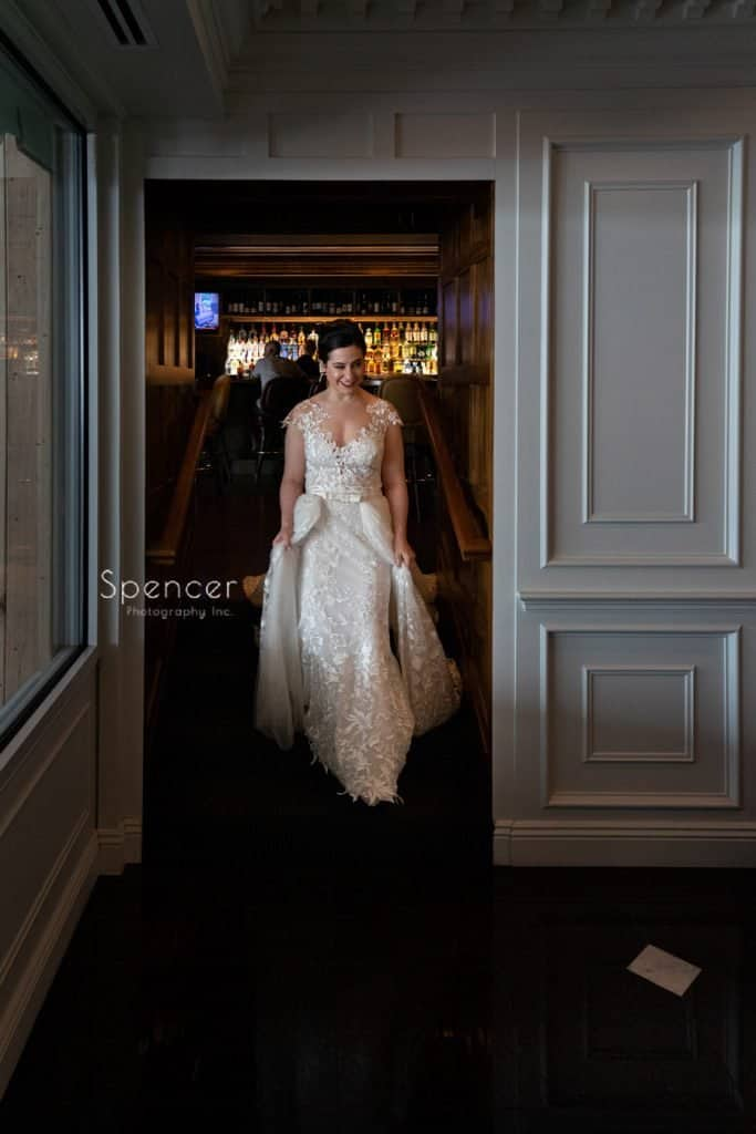 bride walking thru Avalon Resort on her wedding day