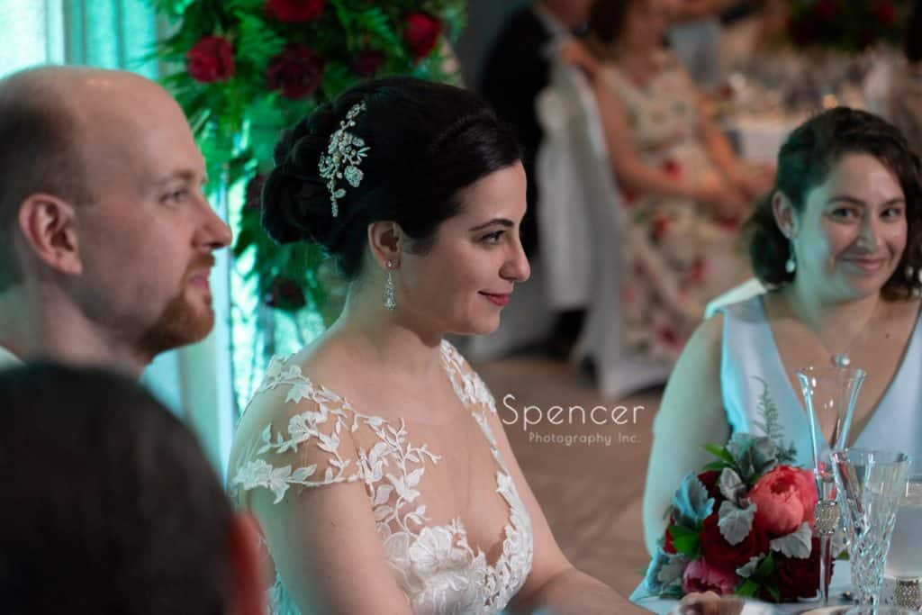 bride reacting to father speech at her wedding reception