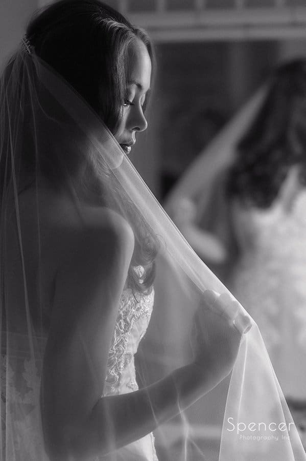 creative black and white picture of bride and her veil