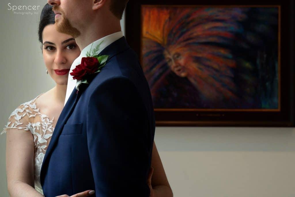 bride hugging groom at butler museum of art